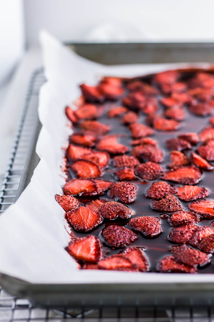 A pan of strawberries roasted in balsamic vinegar + a recipe for balsamic roasted strawberry buttercream