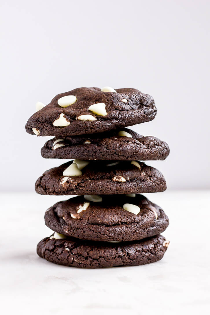 A tall stack of dark chocolate + white chocolate chip cookies | Flour Covered Apron