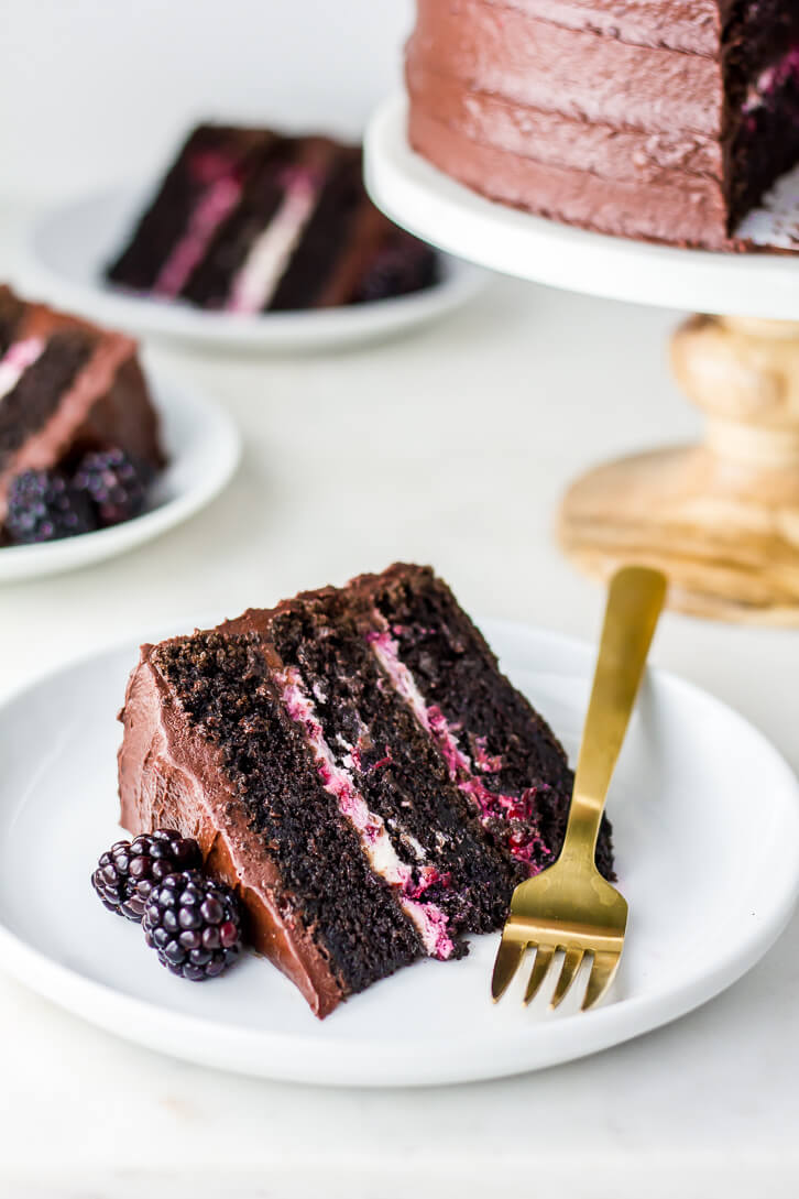 Slices of blackberry chocolate cake with blackberry mascarpone filling and blackberry chocolate frosting | Flour Covered apron