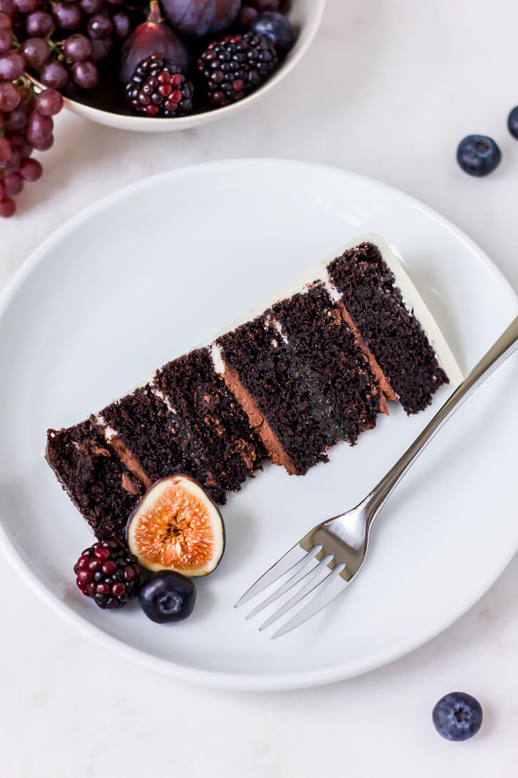 Six layers of dark chocolate cake filled with alternating layers of dark chocolate ganache and salted caramel | Flour Covered Apron