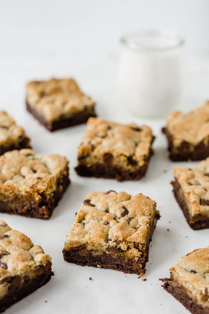 Caramel Stuffed Brookie Bars and a glass of milk   Flour Covered Apron