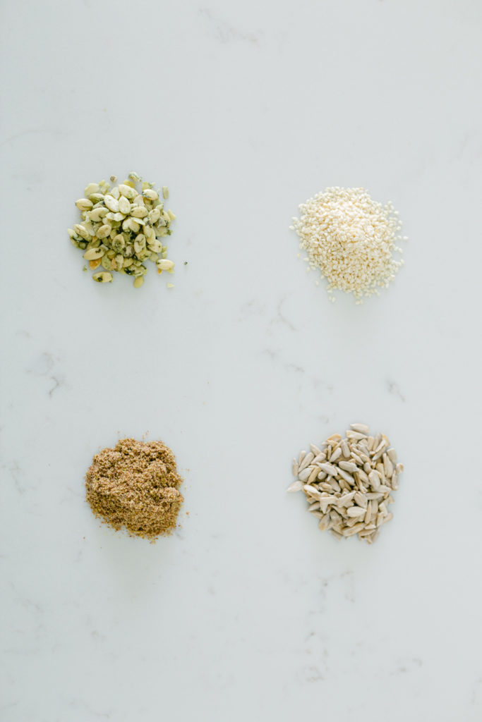 Flaxseeds, pumpkin seeds, sunflower seeds, and sesame seeds for seed cycling.