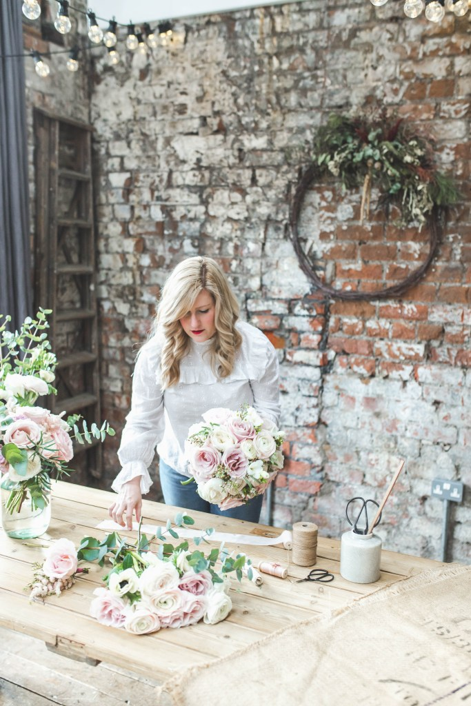 Zoe florist at Flourish and Grace Bristol uses roses and ranunculus to create a wedding bridal bouquet