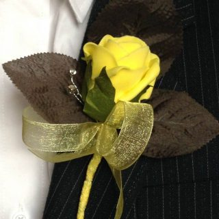 Yellow rose with brown leaves and diamantes