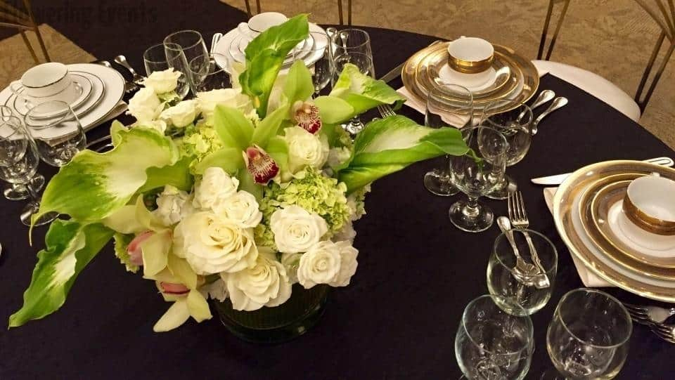 Centerpiece with green callas, cymbidiums and hydrangea and white roses
