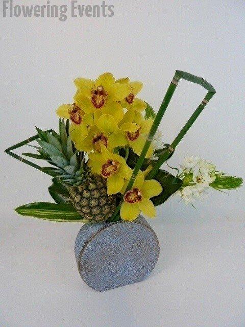 Yellow cymbidiums, orinthogalum, and a pineapple
