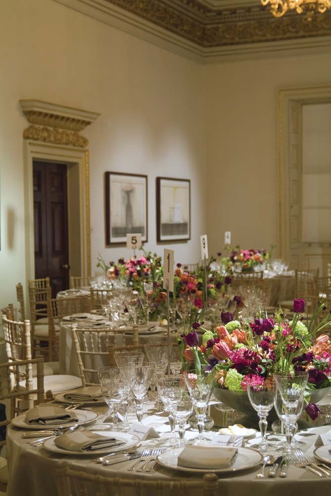 For an event at one of London's leading museums, Connolly created low centerpieces of electric-hued spring blooms in low bowls. (Photo Courtesy of Shane Connolly LLP)