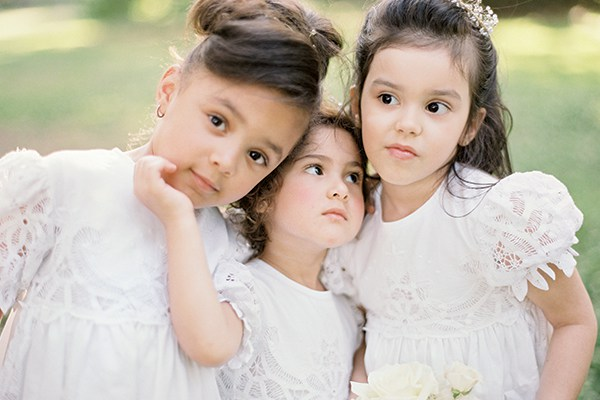 The flower girls wore dresses handmade with lace from vintage tablecloths.