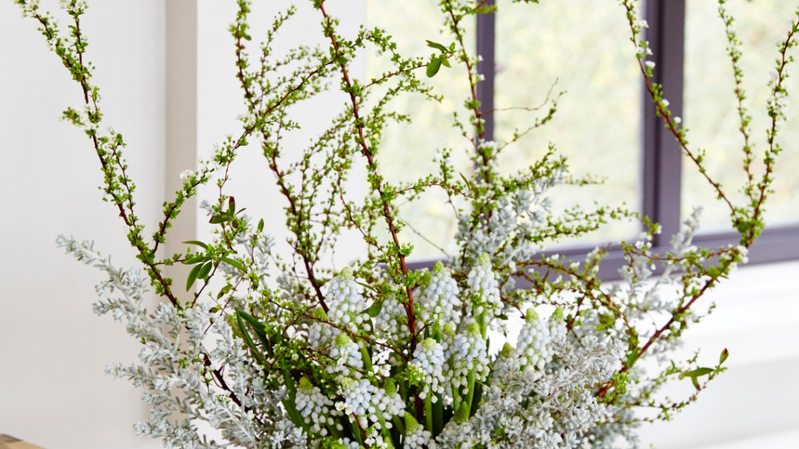 silver and white flower arrangement