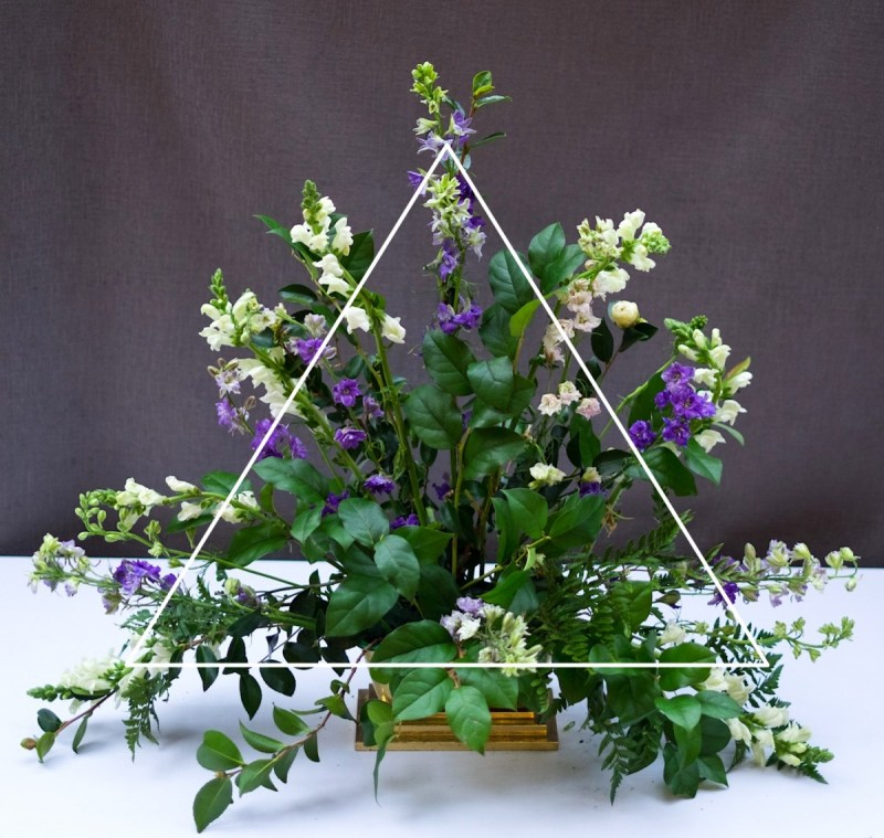 classic triangle church flower arrangement