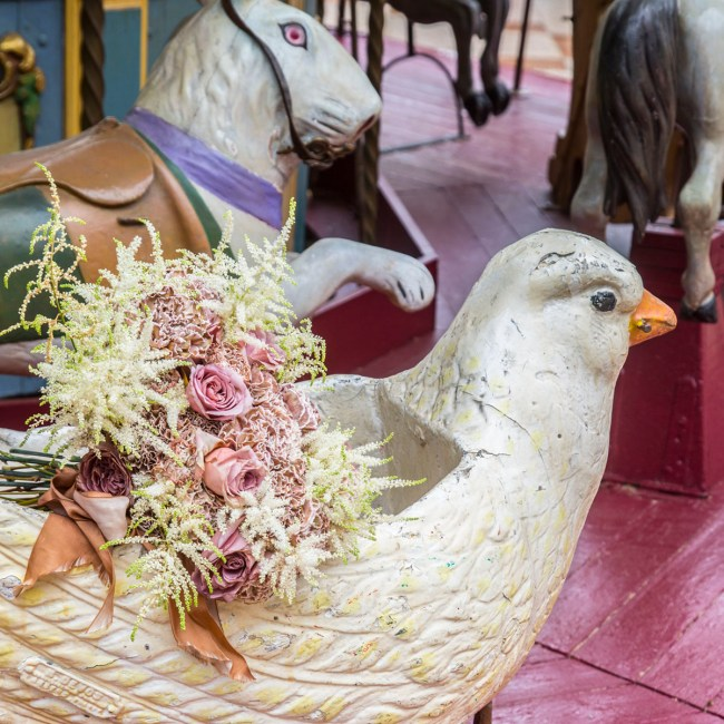 Laura Dowling bouquet on a Parisian carousel pigeon