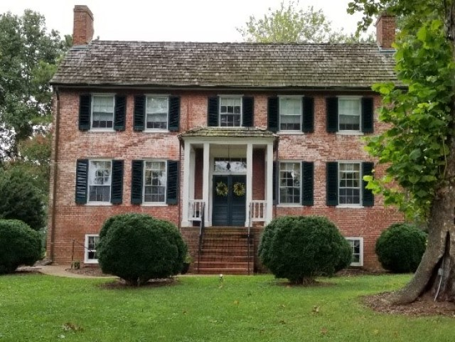 photo of Middle Peninsula home for Historic Garden Week photo – pink house with porch on Bay Street