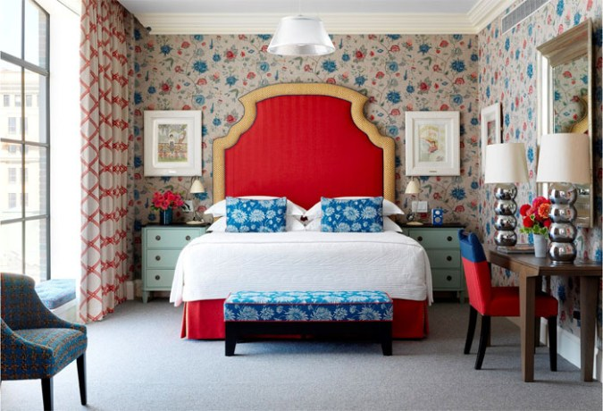 Crosby Street Hotel room with red headboard and floral wallpaper