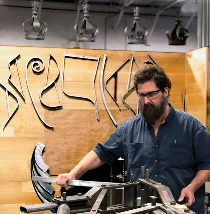 An artisan creates furniture at McKinnon and Harris in Richmond, Virginia