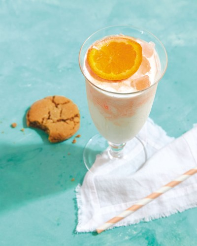 Orange and cream cocktail served with a Five-Spice Gingersnap