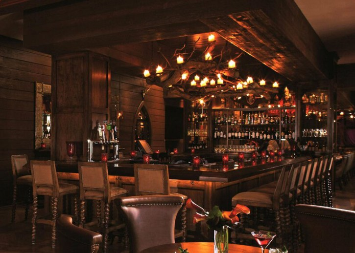 Best hotels in Asheville, NC: The dark, cozy hunting-lodge-esque bar of Grand Bohemian Hotel