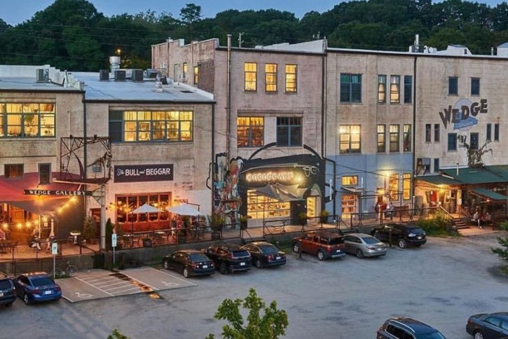 Best shopping in Asheville, NC: Street scene of a row of funky shops, including The Wedge, in River Arts District