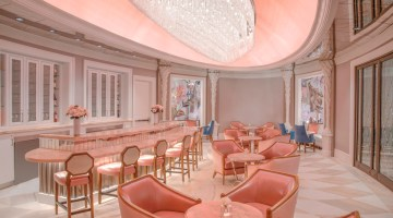 The pink, opulent interior of Camellias at Hotel Bennet in Charleston, SC