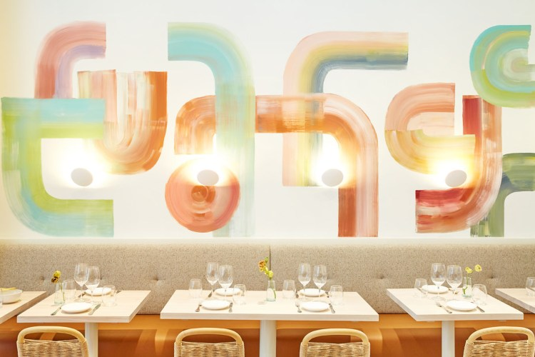 tables, chairs, banquets and abstract mural of muted colors at Il Florista in New York City
