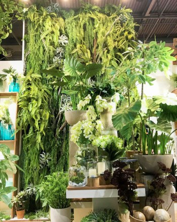 Scene from Maison & Objet 2020: wall covered in green foliage with containers of lush greenery in the foreground