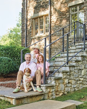family of Landscape Architect Gavin Duke, sitting on the stone steps of their Nashville home