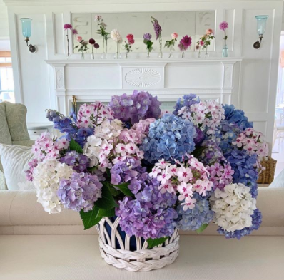 Floral arrangement by Cathy Graham, featuring purple, pink, blue and white spring flowers