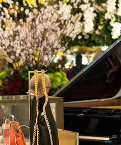 Handbags and a grand piano.