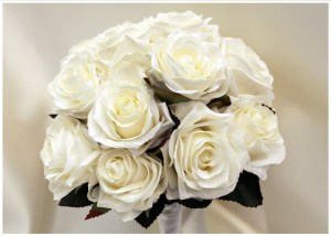 Formal rose posy with open white roses.