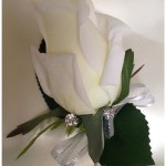 White rose button hole with diamantes added.