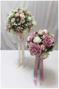 Bridal and bridesmaid posies with roses, gyp, gum and trailing ribbon bow.