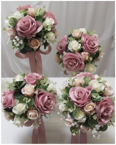 Bridesmaid's posies with mauve, champagne and ivory roses, gum and gyp.