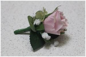 Mauve rose, gum and gyp buttonhole.