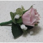 Mauve rose, gum and gyp buttonhole.