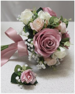 Bridesmaid posy with match groomsmen buttonhole. Mauve roses, gum and gyp.