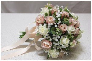 Bridal posy with champagne and ivory roses, gum and gyp.