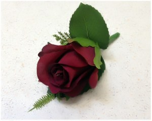 Burgundy rose buttonhole