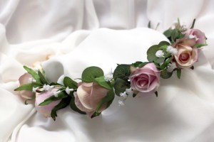 Flower girl crown with pink and champagne roses, gyp and gum leaves.