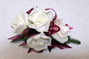 White roses with burgundy ribbon.