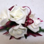 White roses with burgundy ribbon.