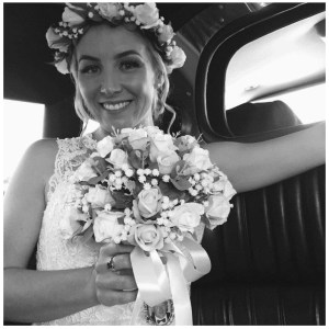 Bride with bouquet and hair circlet.