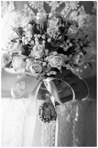 Bridal posy with roses, gum and baby's breath.