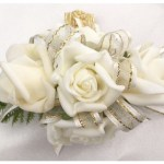 White roses, ivory organza ribbon with gold thread.