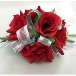 Bright red roses with grey organza ribbon with silver thread.
