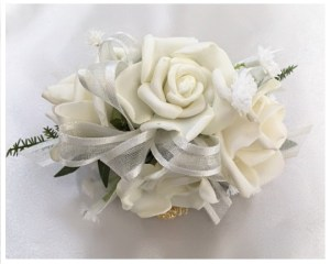 White roses, ivory organza ribbon and baby's breath.