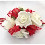 White roses with red organza ribbon.