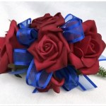 Deep red roses with electric blue organza ribbon with satin trim.