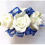 White roses, electric blue organza ribbon, pearl wrist band.