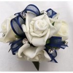 White roses, navy organza/satin trim ribbon, diamantes added.