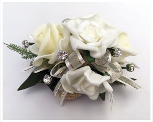White roses, ivory ribbon with gold thread and diamantes added.