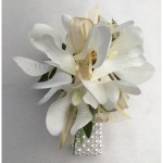 Orchids with gold organza ribbon, pearl wristband.